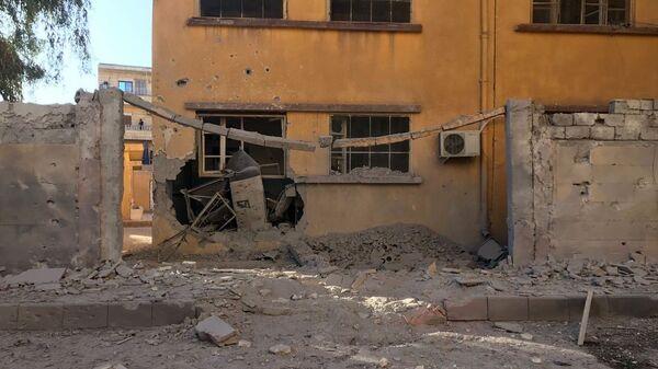 Последствия обстрела жилых районов в Сирии