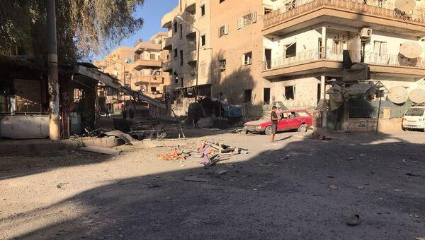 Последствия ракетного обстрела квартала Аль-Кусур в Дейр-эз-Зоре. Архивное фото