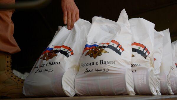 Жители Сирии получили гуманитарную помощь от России. Архивное фото