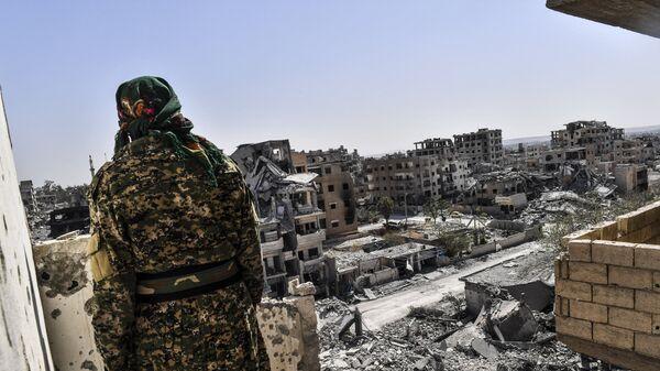 Боец Сирийских демократических сил в Сирии