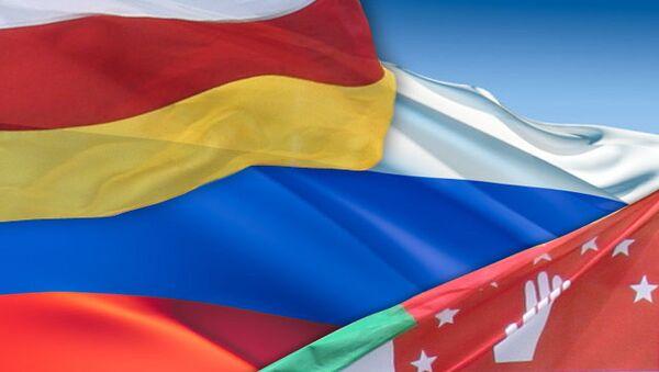 Флаги Осетии, России, Абхазии