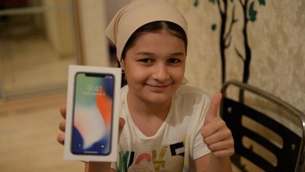 Хеда Ульбиева, выигравшая iPhone X за лучшее стихотворение о президенте РФ Владимире Путине