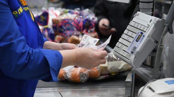 Visa работает над сервисом выдачи наличных на кассах магазинов