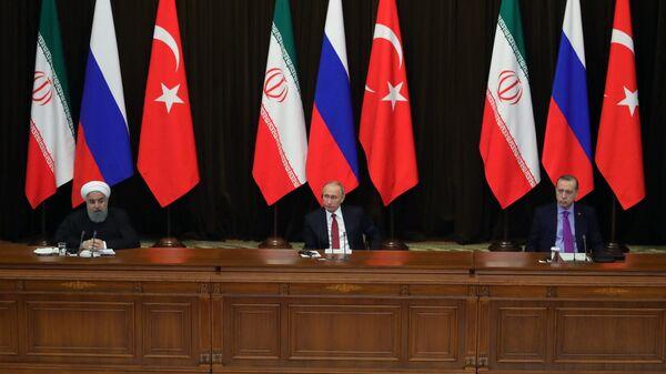 Владимир Путин, президент Ирана Хасан Рухани и президент Турции Реджеп Тайип Эрдоган