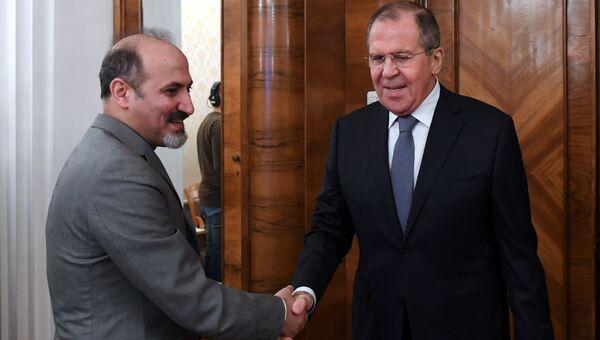 Министр иностранных дел РФ Сергей Лавров и лидер сирийского оппозиционного движения Сирия завтра Ахмед аль-Джарба во время встречи. 27 декабря 2017