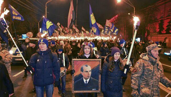 Активисты различных националистических партий во время митинга в честь 109-летия Степана Бандеры в Киеве, Украина. 1 января 2018