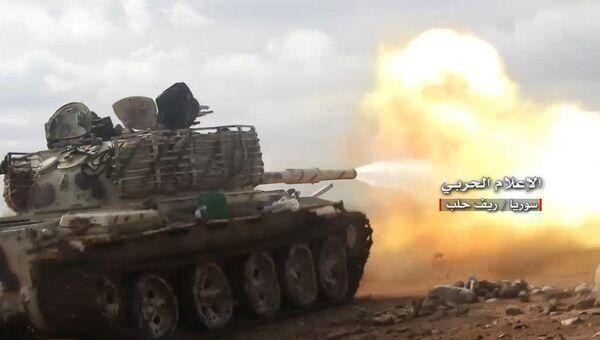 Танк сирийской правительственной армии во время операции против оппозиционных сил в провинции Алеппо. 20 января 2018