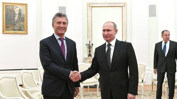 Президент РФ Владимир Путин и президент Аргентинской Республики Маурисио Макри во время встречи. 23 января 2018