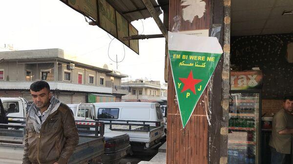 Флаг курдских сил самообороны (YPJ)
