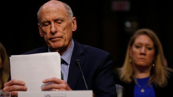 Директор Национальной разведки США Дэн Коутс на слушании доклада Всемирные угрозы в Сенатском комитете по разведке в Вашингтоне. 13 февраля 2018