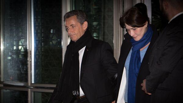 Экс-президент Франции Николя Саркози  выходит из офиса французского телевидения TF1 после выступления в вечерних новостях. 22 марта 2018