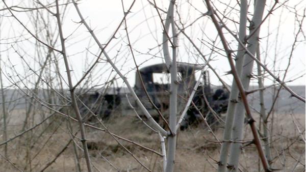 Расстрелянный украинскими силовиками медицинский автомобиль Народной милиции ЛНР у линии соприкосновения в Донбассе. 2 апреля 2018