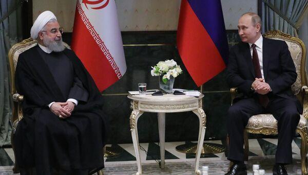 Президент РФ Владимир Путин и президент Исламской Республики Иран Хасан Рухани во время встречи в Анкаре. 4 апреля 2018