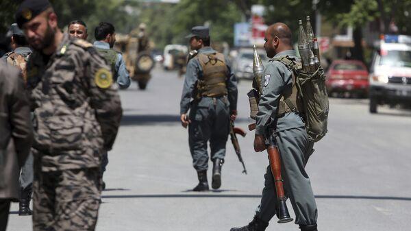 Сотрудники безопасности в центре Кабула, Афганистан. Архивное фото
