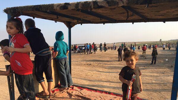 Палестинские дети на акциях протеста на границе сектора Газа с Израилем