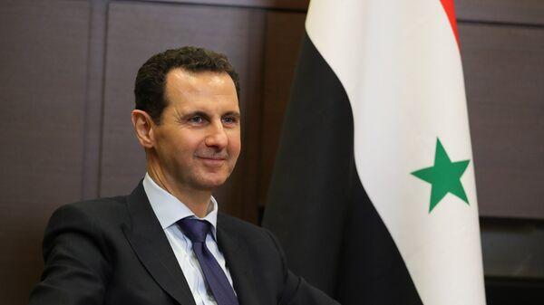 Президент Сирийской арабской республики Башар Асад во время встречи с президентом РФ Владимиром Путиным. 17 мая 2018