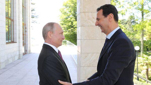Президент РФ Владимир Путин и президент Сирийской арабской республики Башар Асад