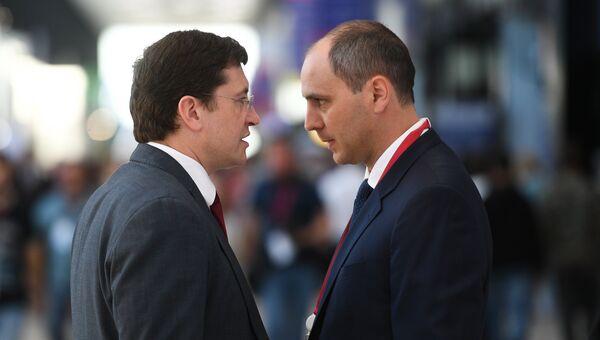 Временно исполняющий обязанности губернатора Нижегородской области Глеб Никитин (слева) во время Петербургского международного экономического форума