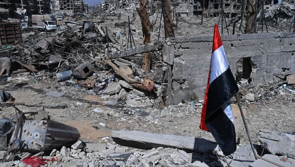 Разрушенные здания на территории бывшего лагеря палестинских беженцев Ярмук в Сирии. Архивное фото