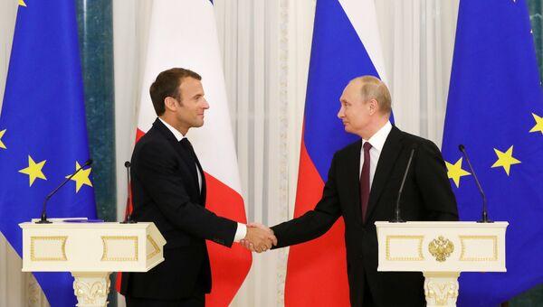 Президент РФ Владимир Путин и президент Франции Эмманюэль Макрон на пресс-конференции по итогам встречи. 24 мая 2018
