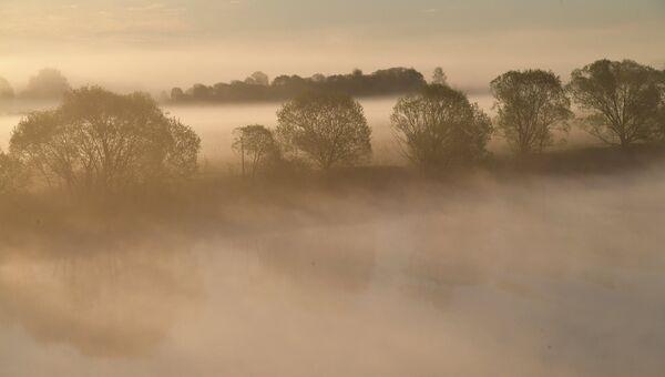 Восход солнца на реке. Архивное фото