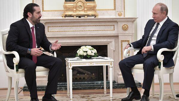 Президент РФ Владимир Путин и премьер-министр Ливана Саад Харири во время встречи. 13 июня 2018