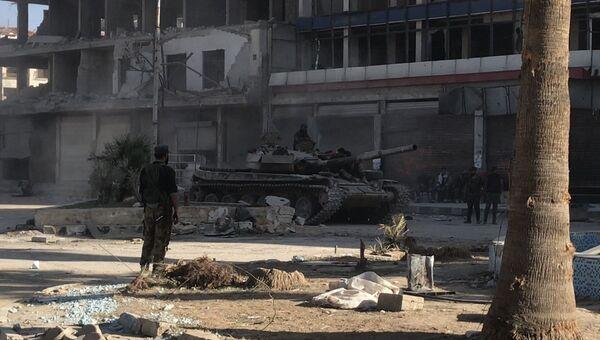 Бронетехника сирийской армии в освобожденном населенном пункте в восточной Гуте. Архивное фото