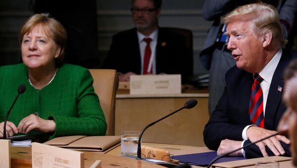 Ангела Меркель и Дональд Трамп на саммите G7 в Квебеке. Июнь 2018