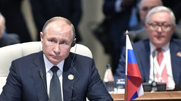 Президент РФ Владимир Путин во время встречи лидеров БРИКС. 26 июля 2018