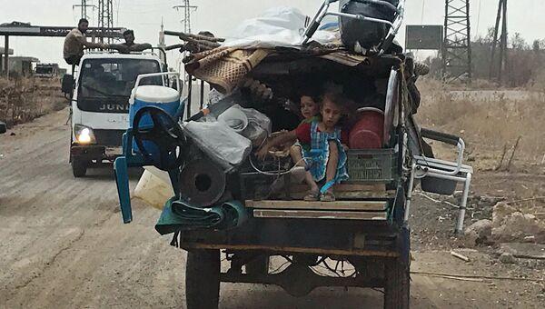 Дети в автомобиле на юго-западе сирийской провинции Дераа