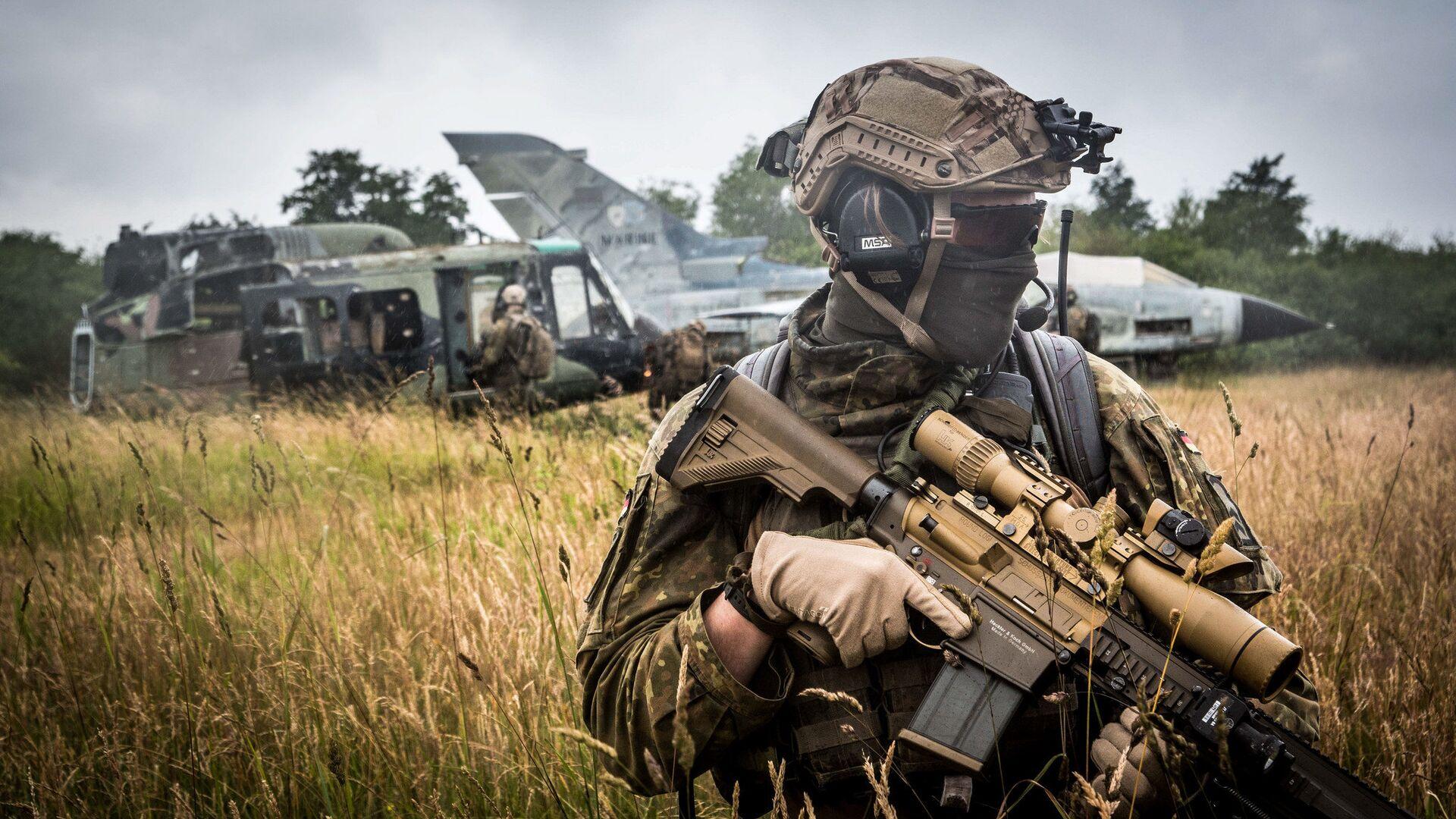 Военнослужащий войск НАТО во время учений в Германии. Июнь 2018 - РИА Новости, 1920, 22.01.2021