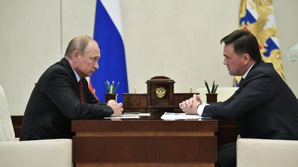Президент РФ Владимир Путин и губернатор Московской области Андрей Воробьев  во время встречи. 30 августа 2018