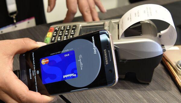 Система оплаты Samsung Pay. Архивное фото