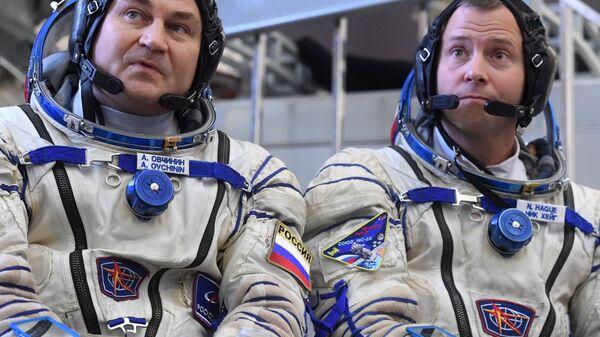 Космонавт Роскосмоса Алексей Овчинин и астронавт НАСА Ник Хейг. Архивное фото