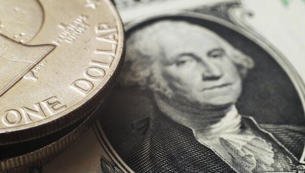 Монета и банкнота номиналом в один доллар США