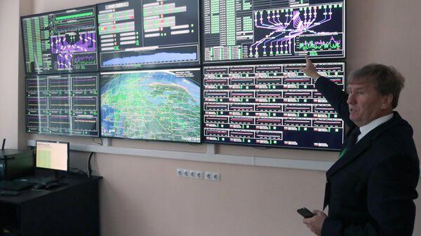 Директор Лаборатории информационных технологий Владимир Кореньков