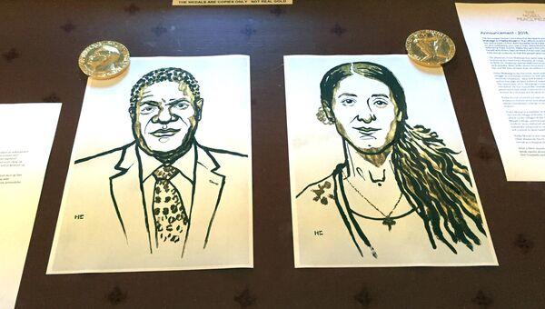 Рисунки с портретами лауреатов Нобелевской премии мира 2018 Дениса Муквеге и Нади Мурад