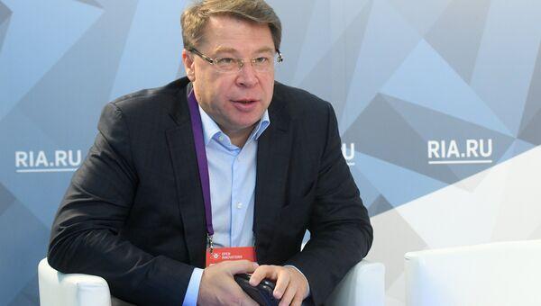 Президент НП ГЛОНАСС Александр Гурко  во время интервью на стенде МИА Россия сегодня на международном форуме Открытые инновации - 2018. 16 октября 2018