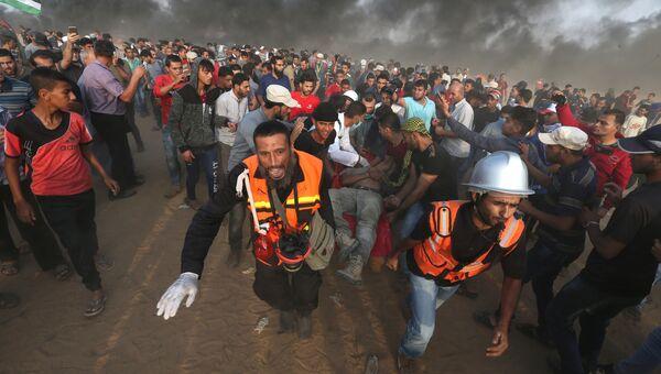Столкновения палестинцев с израильскими военными на границе с сектором Газа