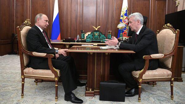 Президент РФ Владимир Путин и мэр Москвы Сергей Собянин во время встречи. 22 октября 2018