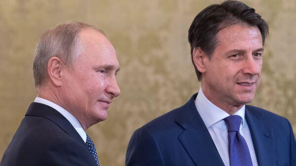 Владимир Путин и премьер-министр Италии Джузеппе Конте во время встречи. 24 октября 2018