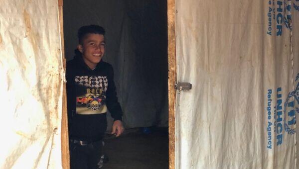 Дети сирийских беженцев в долине Бекаа в Ливане