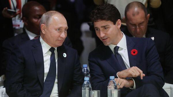 Президент РФ Владимир Путин и премьер-министр Канады Джастин Трюдо на Парижском форуме мира. 11 ноября 2018