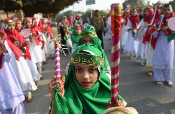Пакистанские мусульманки во время празднования Милад-Ун-Наби в Карачи. 21 ноября 2018 года