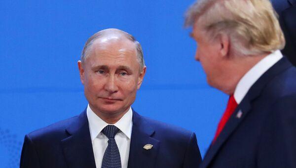 Президент России Владимир Путин и Президент США Дональд Трамп на саммите лидеров «большой двадцатки» в Буэнос-Айресе, Аргентина. 30 ноября 2018