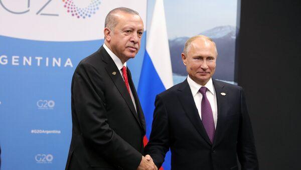 Президент РФ Владимир Путин и президент Турции Реджеп Тайип Эрдоган во время встречи на полях саммита Группы двадцати G20 в Буэнос-Айресе. 1 декабря 2018
