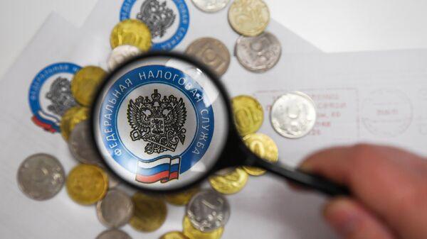 Монеты и конверты с логотипом ФНС РФ