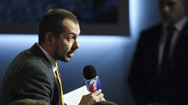 Украинский журналист Роман Цимбалюк на ежегодной большой пресс-конференции президента РФ Владимира Путина