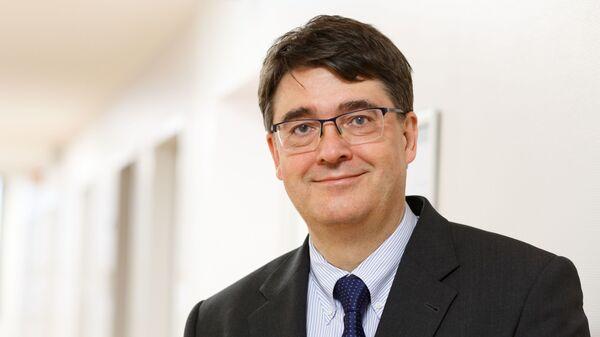Глава Немецкого научно-исследовательского онкологического центра в Гейдельберге Михаэль Бауманн
