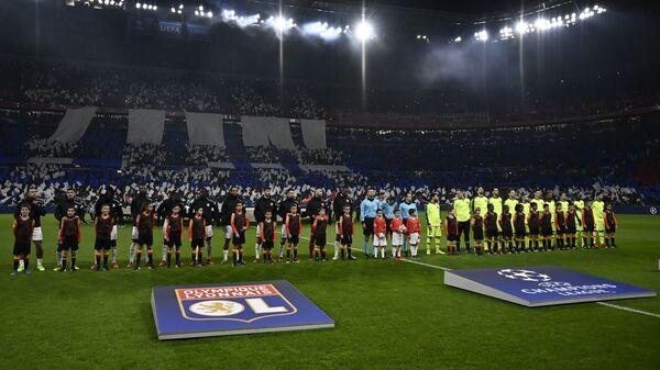 Футболисты Лиона и Барселоны